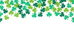 St Patricks Day paper shamrocks top border over white. St Patricks Day top border of paper shamrocks over a white background Royalty Free Stock Photos