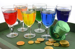 St Patricks Day party rainbow color drinks on green tray. Happy St Patricks Day party rainbow color drinks with decorations on vintage wood table Stock Photo