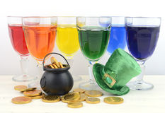 St Patricks Day party rainbow color drinks. Happy St Patricks Day party rainbow color drinks with decorations on vintage wood table Royalty Free Stock Images