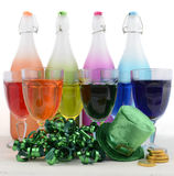 St Patricks Day party rainbow color drinks. Happy St Patricks Day party rainbow color drinks with decorations on vintage wood table Stock Photos