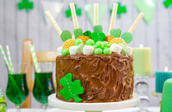 St Patricks Day Party Table with Chocolate Cake. Happy St Patricks Day, March 17, green and white party table with showstopper chocolate cake decorated with Royalty Free Stock Photos