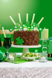 St Patricks Day Party Table with Chocolate Cake Stock Image