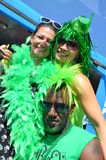 St. Patricks Day Patrons. People dress up and have fun on St. Patrick Day parade. Festive clothing all in green Stock Photography