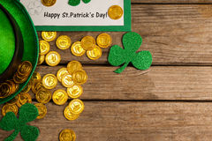 St Patricks Day placard, leprechaun hat with shamrock and gold chocolate coin Stock Photos