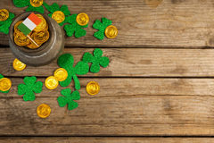 St. Patricks Day pot of chocolate gold coins with irish flag and shamrocks Royalty Free Stock Photos