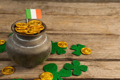 St. Patricks Day pot of chocolate gold coins with irish flag and shamrocks Stock Photos