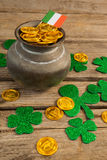 St. Patricks Day pot of chocolate gold coins with irish flag and shamrocks Stock Images