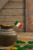 St. Patricks Day pot of chocolate gold coins with irish flag and shamrocks Royalty Free Stock Photo