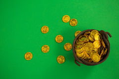 St. Patricks Day pot filled with chocolate gold coins Stock Photography