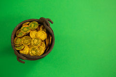 St. Patricks Day pot filled with chocolate gold coins Stock Image