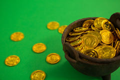 St. Patricks Day pot filled with chocolate gold coins Stock Photos