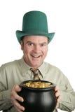 St Patricks Day Pot of Gold. A man celebrating St. Patrick's Day holding a pot of gold.  Isolated on white Stock Photos