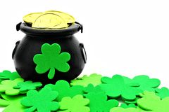 St Patricks Day pot of gold. And shamrocks over white royalty free stock photography