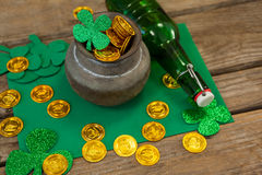 St. Patricks Day shamrock, beer bottle and pot filled with chocolate gold coins Royalty Free Stock Photo