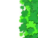St Patricks Day shamrock border. St Patricks Day border of green shamrock confetti over white Royalty Free Stock Photos