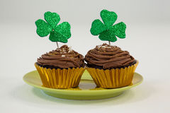 St Patricks Day shamrock on the cupcake kept in plate Royalty Free Stock Photos
