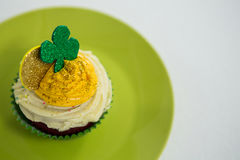 St Patricks Day shamrock on the cupcake kept in plate Royalty Free Stock Images