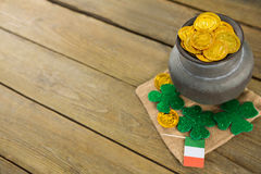 St. Patricks Day shamrock, flag and pot filled with chocolate gold coins Royalty Free Stock Image