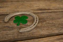 St Patricks Day shamrock with horseshoe. On wooden table Stock Photography