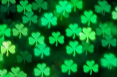 St Patricks Day shamrock light blurred bokeh background royalty free stock images
