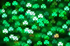St Patricks Day shamrock light bokeh abstract background royalty free stock photos
