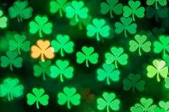 St Patricks Day shamrock light bokeh background Stock Images