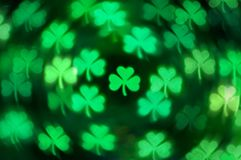 St Patricks Day shamrock light bokeh background royalty free stock photos