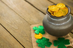 St. Patricks Day shamrock and pot filled with chocolate gold coins Royalty Free Stock Image