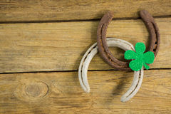 St Patricks Day shamrock with two horseshoes Stock Photos