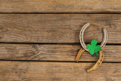 St Patricks Day shamrock with two horseshoes Royalty Free Stock Photo