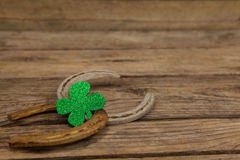St Patricks Day shamrock with two horseshoes Royalty Free Stock Photos