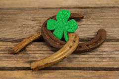 St Patricks Day shamrock with two horseshoes Royalty Free Stock Image