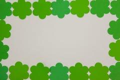 St Patricks Day shamrocks forming rectangle frame Stock Photos