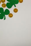 St Patricks Day shamrocks and gold chocolate coins Stock Image