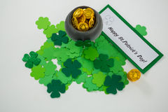 St. Patricks Day shamrocks and pot filled with chocolate gold coins Stock Photo