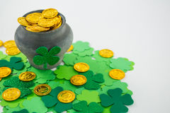 St. Patricks Day shamrocks and pot filled with chocolate gold coins Stock Photography