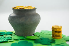 St. Patricks Day shamrocks and pot filled with chocolate gold coins Royalty Free Stock Photo