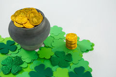 St. Patricks Day shamrocks and pot filled with chocolate gold coins Royalty Free Stock Photos