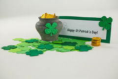 St. Patricks Day shamrocks and pot filled with chocolate gold coins Royalty Free Stock Image