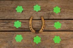 St Patricks Day shamrocks surrounded with horseshoe Royalty Free Stock Photos