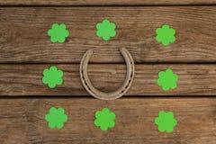 St Patricks Day shamrocks surrounded with horseshoe Royalty Free Stock Images