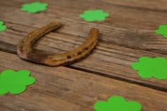 St Patricks Day shamrocks surrounded with horseshoe Royalty Free Stock Image