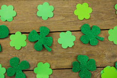 St Patricks Day shamrocks. On wooden table Stock Photo