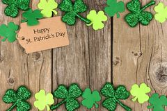 St Patricks Day tag with shramrock double border over wood Royalty Free Stock Photography
