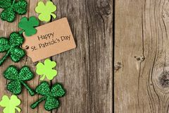 St Patricks Day tag with shramrock side border over wood Stock Image