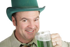 St Patricks Day Thirst. A handsome Irish American man with green beer on St. Patrick's Day.  White background Stock Images
