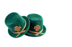 St. Patricks Day Top Hats. Two St. Patrick's Day top hats isolated on white with copy space Stock Images