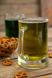 St Patricks Day two mugs of beer with pretzel Royalty Free Stock Photography