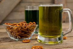 St Patricks Day two mugs of beer with pretzel Royalty Free Stock Image