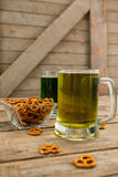 St Patricks Day two mugs of beer with pretzel Royalty Free Stock Photos